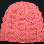 Faceted Lace and Cables Baby Hat for Straight Needles
